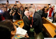Judge Dennise Garcia, left front, watches as George Harris, center left, 82, and Jack Evans, center right, 85, kiss after being married by Judge Garcia Friday, June 26, 2015, in Dallas. Gay and lesbian Americans have the same right to marry as any other couples, the Supreme Court declared Friday in a historic ruling deciding one of the nation's most contentious and emotional legal questions. Celebrations and joyful weddings quickly followed in states where they had been forbidden. (AP Photo/Tony Gutierrez)